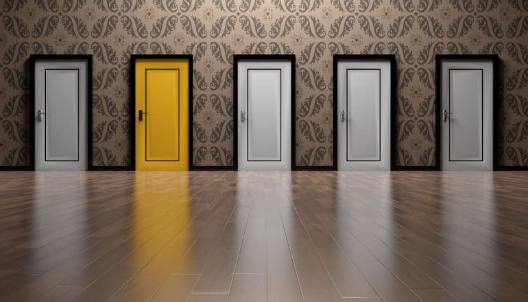 four white doors and one yellow door