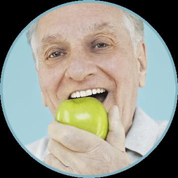 Elder man eating a green apple